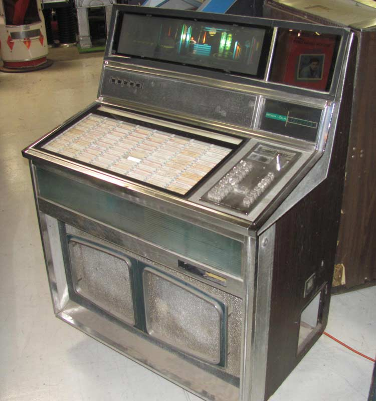... rock ola jukebox ultra model 437 curved frontg glass lights only stock: http://www.rcvintage.com/?name=ROCK-OLA-JUKEBOX&product=1030268822
